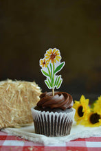 Load image into Gallery viewer, Sunflower cupcake topper on a chocolate cupcake from our farm party theme