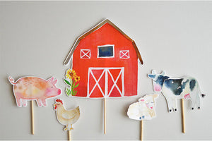 A barn, pig, chicken, sheep and cow cake toppers farm party theme