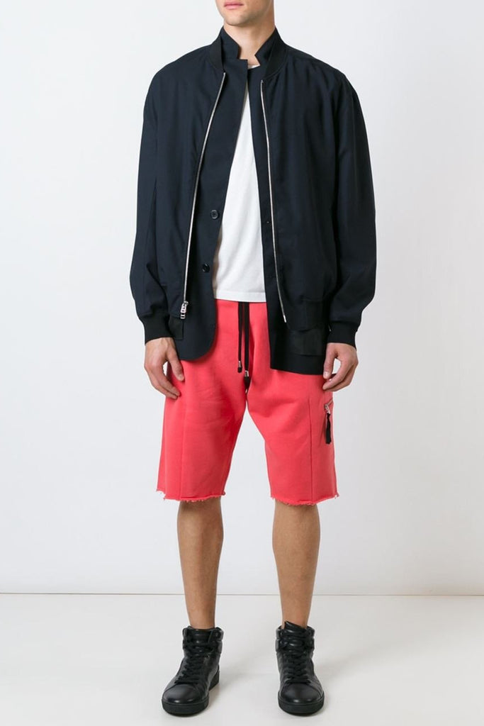 UNCONDITIONAL Coral raw finish luxe sweat shorts with low zip pocket and rib waistband.
