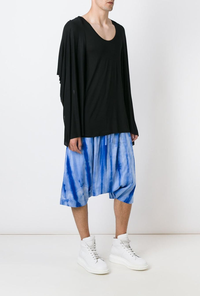 UNCONDITIONAL blue spray striped elasticated waist short harem trousers.