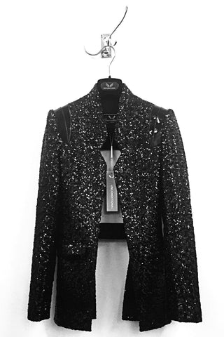 UNCONDITIONAL Black cutaway jacket with shoulder straps and gunmetal ring.
