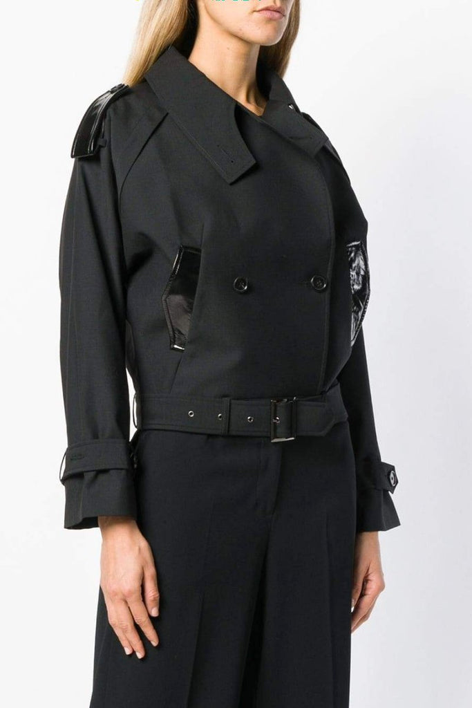 "UNCONDITIONAL AW19 Black abbreviated ""mac"" with epaulettes and leather detailing."