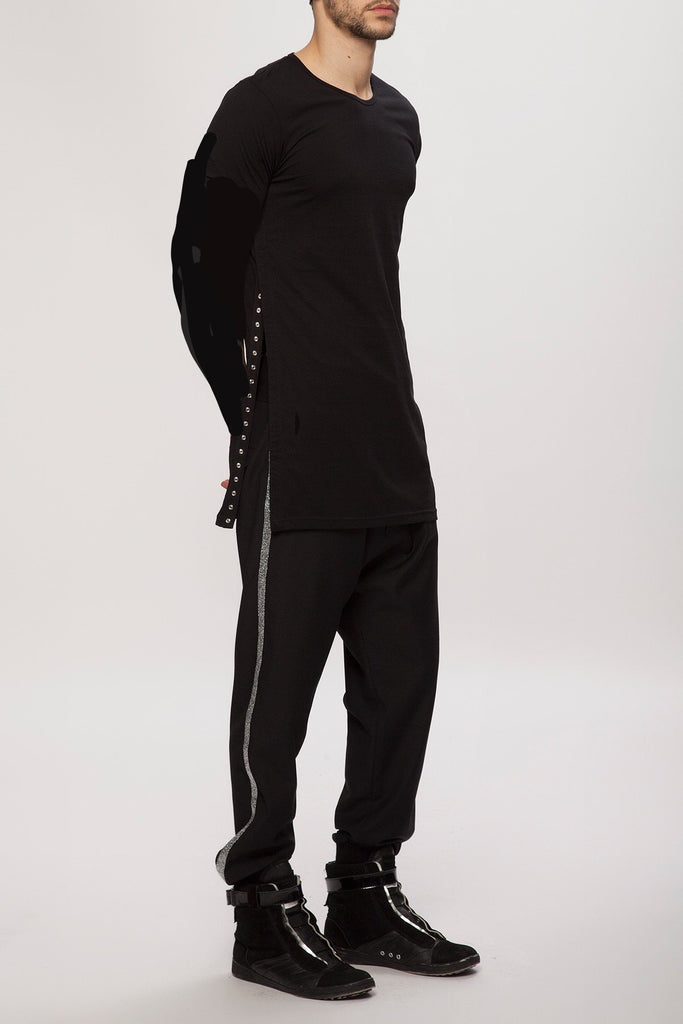 UNCONDITIONAL Black crew neck long sleeved tee with side zip openings.