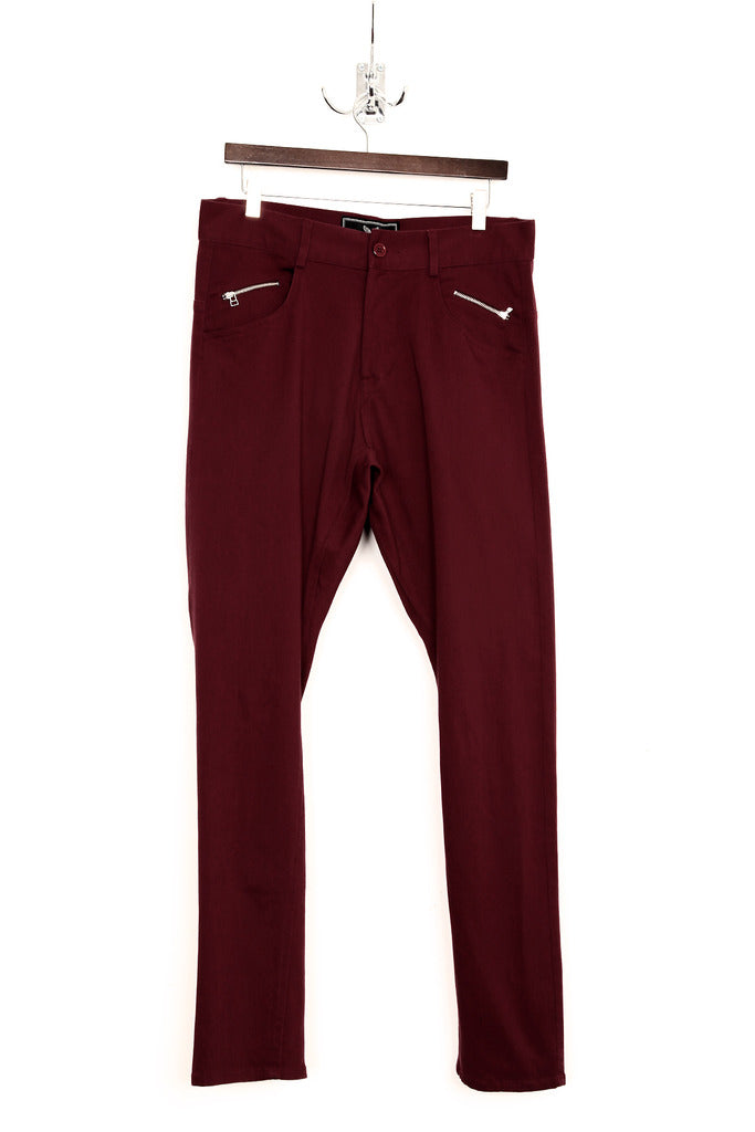UNCONDITIONAL damson stretch drill drop crotch back zip jeans.