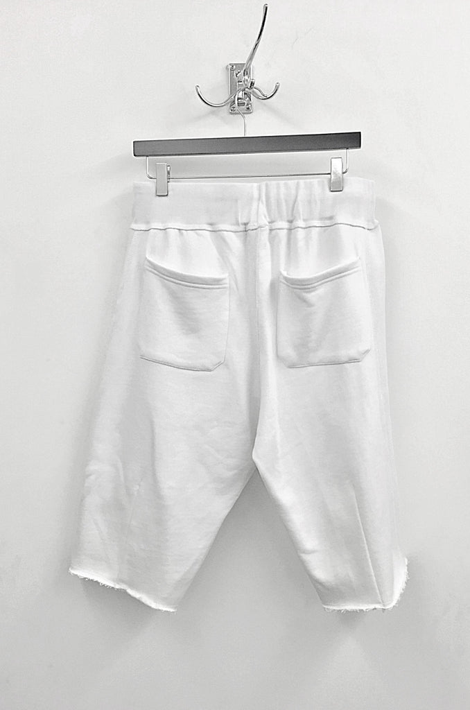 unconditional white knee length luxe raw finish sweat shorts