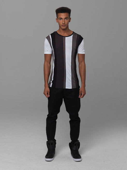 UNCONDITIONAL BLACK, WHITE, MILITARY AND TAR PATCHWORK TEE.