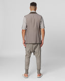 UNCONDITIONAL Desert sand cold dye drop crotch trousers with double contrast zip detailing