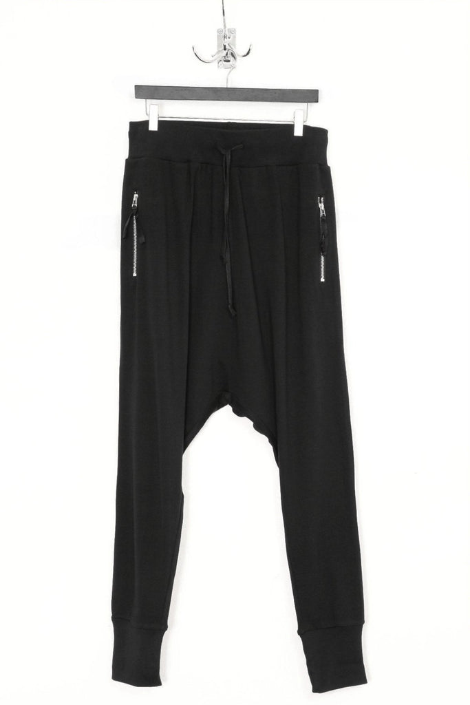 UNCONDITIONAL Black drop crotch jersey trousers with single zip pockets.