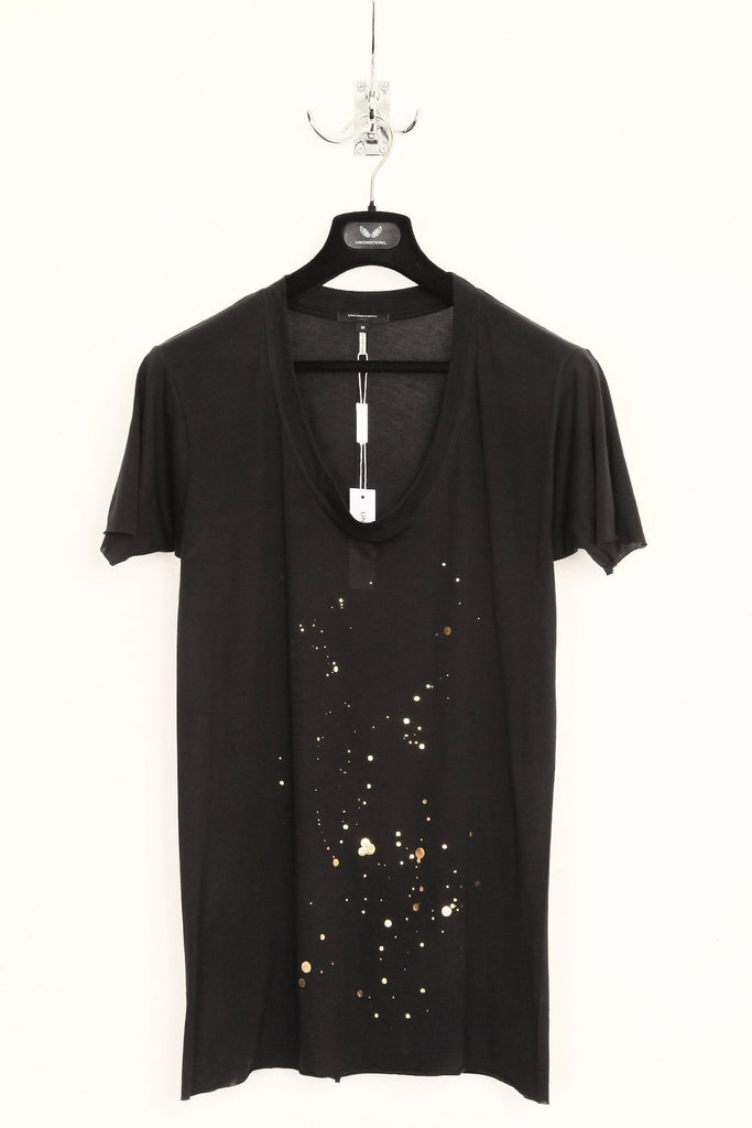 UNCONDITIONAL black spill neck tee with gold ink splat print.