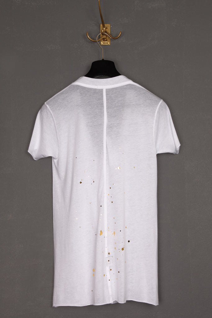UNCONDITIONAL white spill neck tee with gold ink splat print.