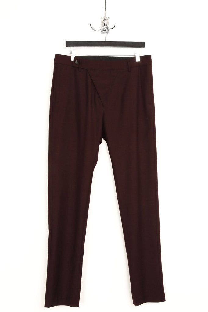 UNCONDITIONAL Burgundy Asymmetric fly trousers.