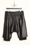 UNCONDITIONAL black shiny creased microfibre drop crotch shorts.