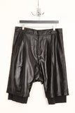 UNCONDITIONAL black creased microfibre double layer drop crotch shorts.