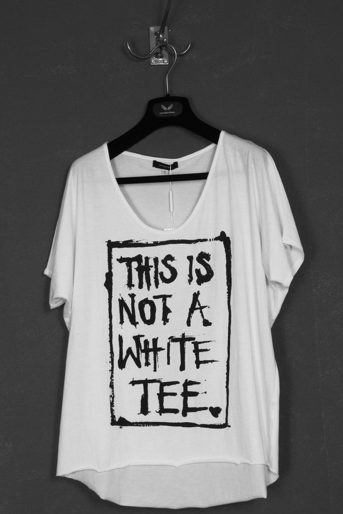 "UNCONDITIONAL white cropped tee with ""This is not a white tee"" print."