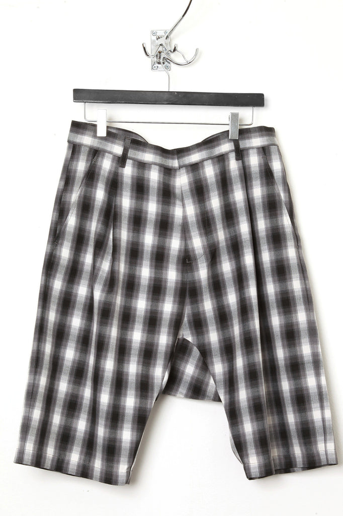 UNCONDITIONAL Grey check tailored drop crotch shorts.