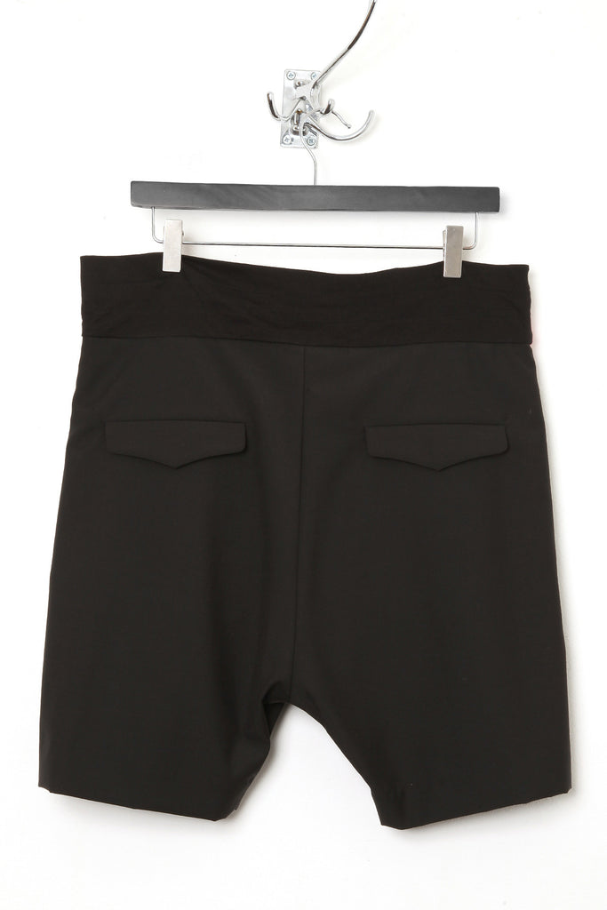"UNCONDITIONAL SS16 Black wool tailored ""boxer"" shorts, with silver and pink contrast waistband."