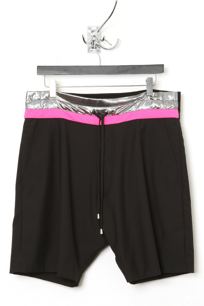 "UNCONDITIONAL Black wool ""boxer"" shorts, with silver and pink contrast waistband."