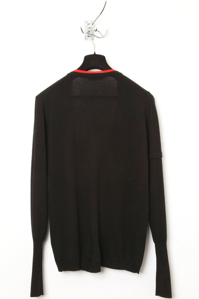 UNCONDITIONAL Black tipped with Red, super deep V-neck merino wool jumper.