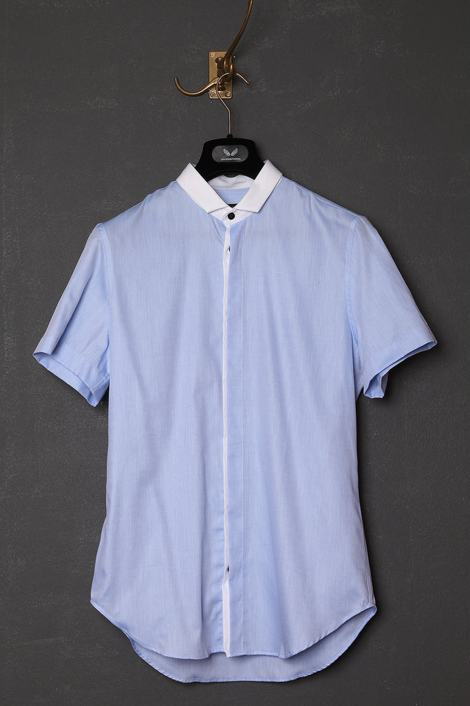 UNCONDITIONAL pale blue and white short sleeved shirt.