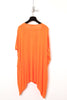 UNCONDITIONAL Orange asymmetric shoulder double dip tee.