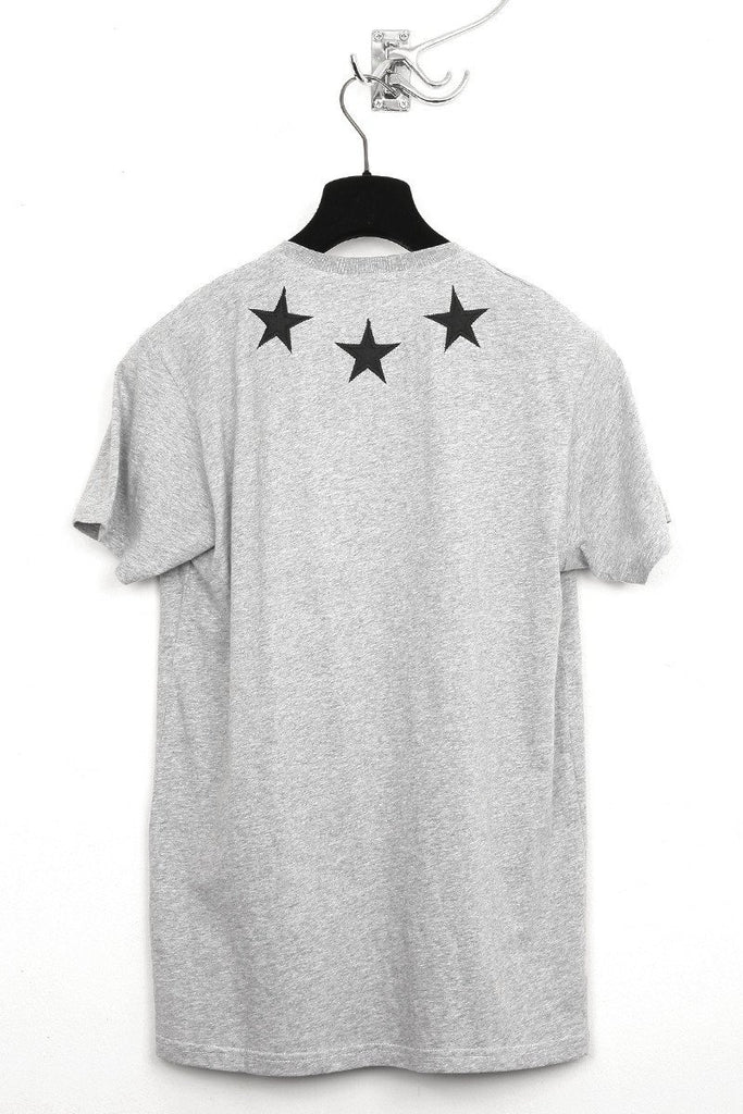 UNCONDITIONAL flannel and black v neck t-shirt with silk stars.