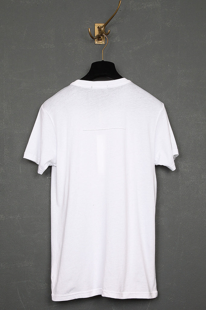 UNCONDITIONAL white bib t-shirt with an applied silver metal poppers.
