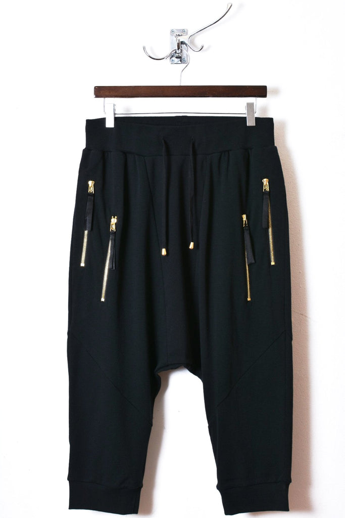 UNCONDITIONAL Black short harem trousers with double GOLD zip pockets