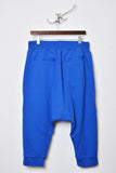 UNCONDITIONAL Lapis blue drop crotch shorts, with gold zips and black contrast tape pocket detailing