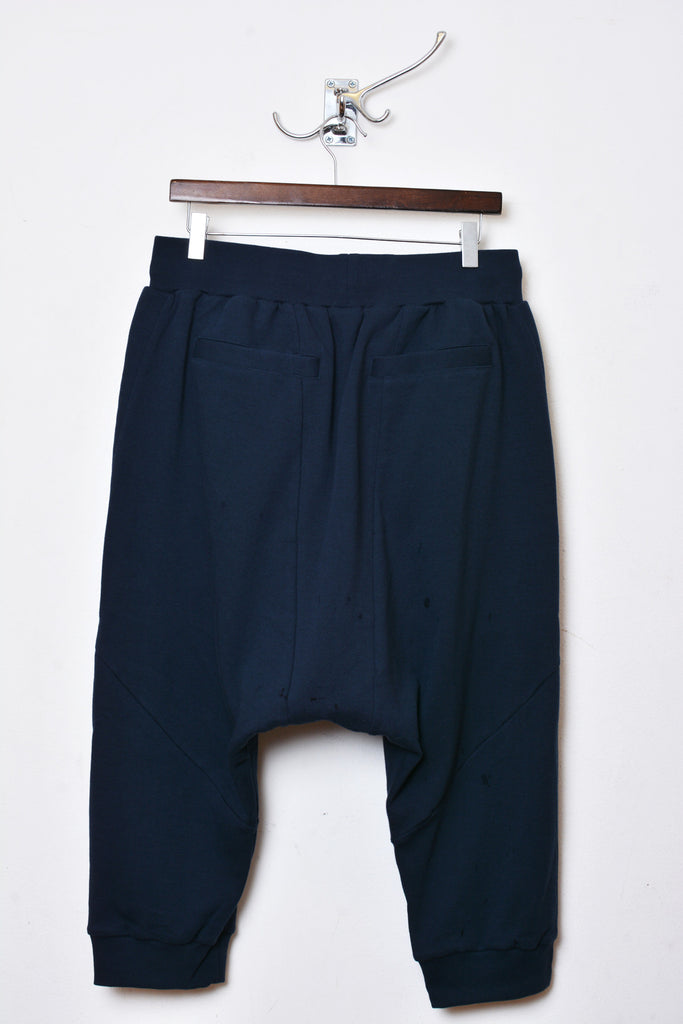 UNCONDITIONAL petrol blue drop crotch 3/4 trousers , with double zip pocket detailing