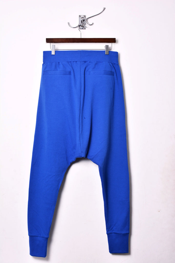UNCONDITIONAL Lapis blue drop crotch full length trousers with double zip pockets.