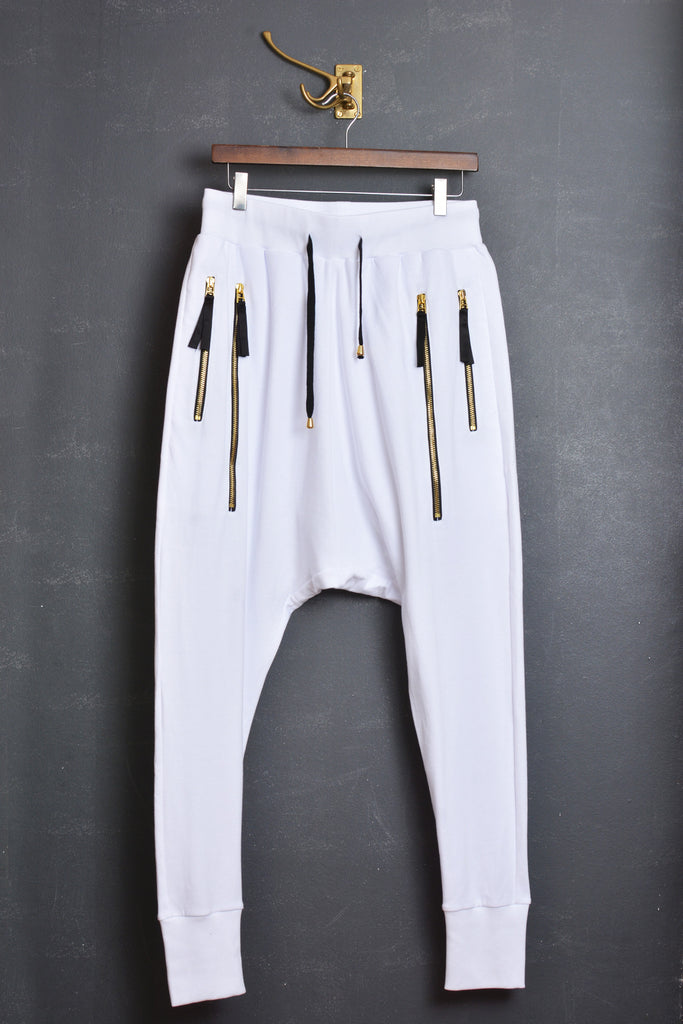 UNCONDITIONAL white cotton drop crotch sarouel jogger trousers with double gold zip pockets