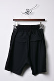 UNCONDITIONAL tailored black and silver boxer shorts with stripe front waistband.