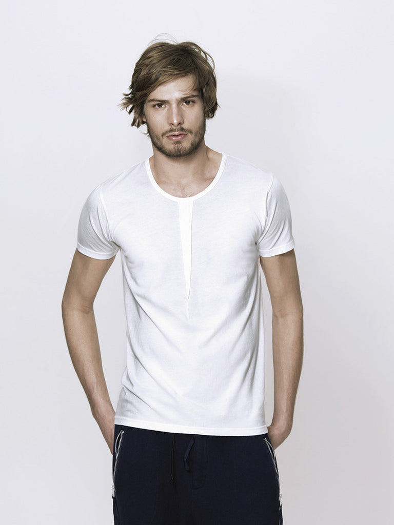 UNCONDITIONAL White cotton crew neck T shirt with front and back neck pleat. Q26