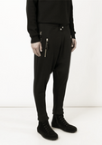 UNCONDITIONAL SS18 signature Black drop crotch full length trousers with double gold zip pockets.