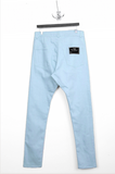 UNCONDITIONAL SS20 Sky blue zip pocket biker jeans.