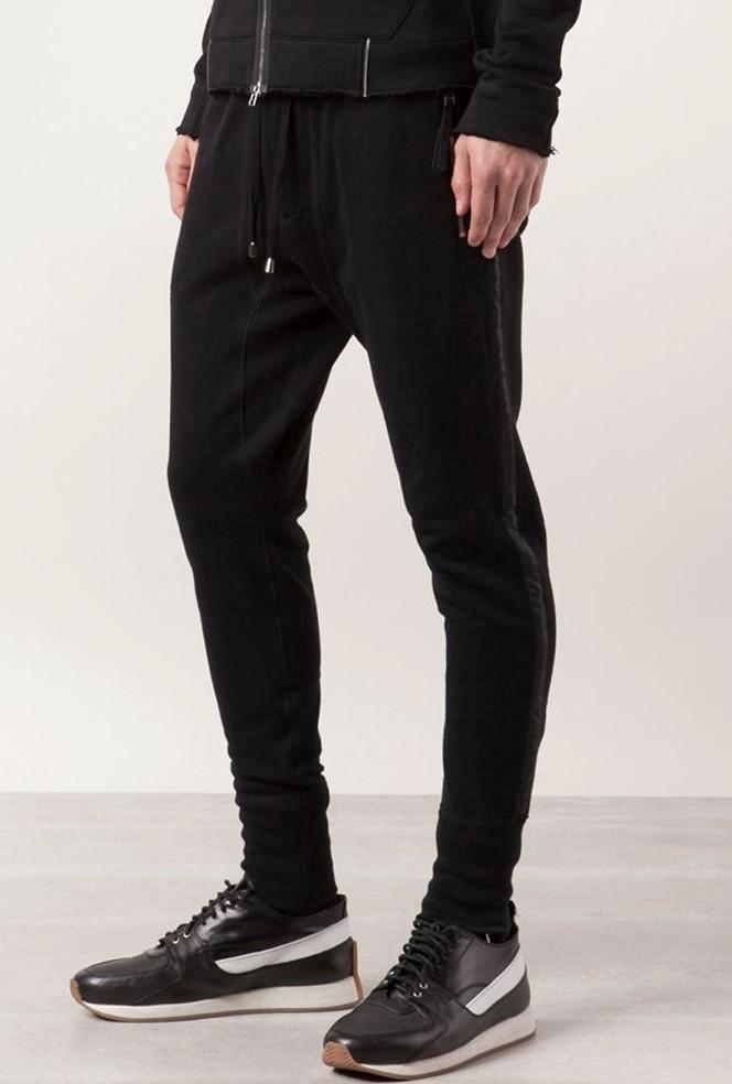 UNCONDITIONAL black slim fit sweat shirting trousers with a microfibre tuxedo stripe.