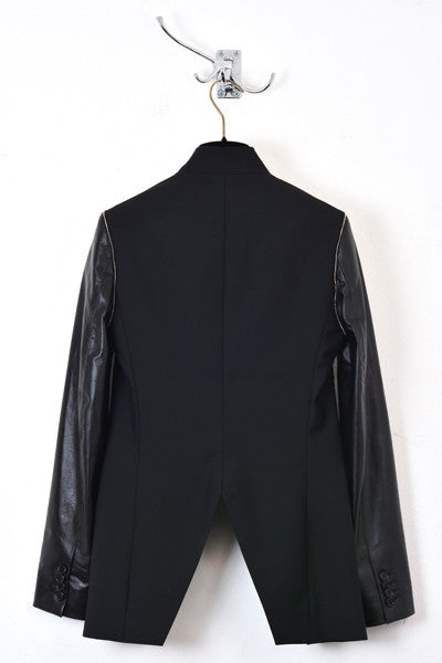 UNCONDITIONAL BLACK CUTAWAY JACKET WITH LEATHER SLEEVES AND ZIP TRIM.