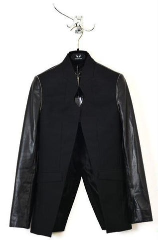 UNCONDITIONAL signature black long coat with zip out panel.