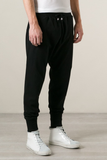UNCONDITIONAL petrol full length higher crotch jersey trouser with zip up back pockets.