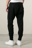 UNCONDITIONAL SS18 black full length jersey trouser with zip up back pockets.