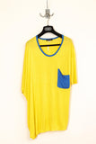 UNCONDITIONAL's yellow oversized tee with contrast draped pocket.
