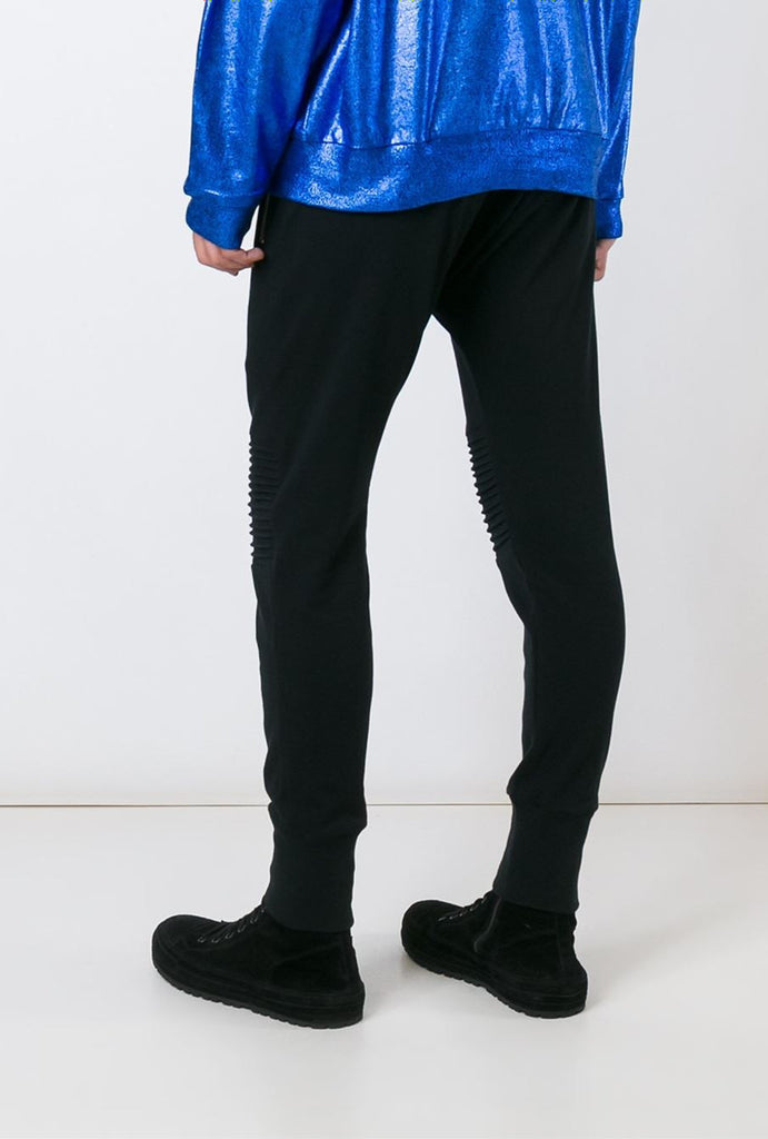 UNCONDITIONAL black full length jersey trouser with knee piping detail.