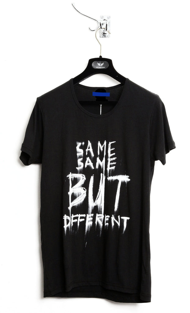 "UNCONDITIONAL SS19 Black T with white ""SAME SAME BUT DIFFERENT"" print."