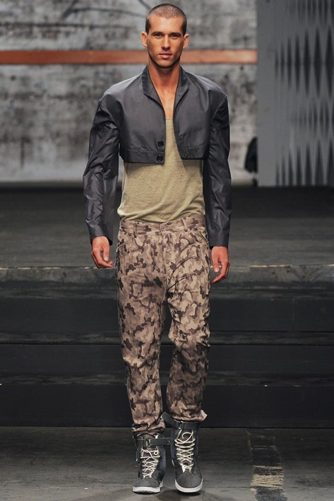 UNCONDITIONAL woven camouflage drill with back zip drop crotch jeans.
