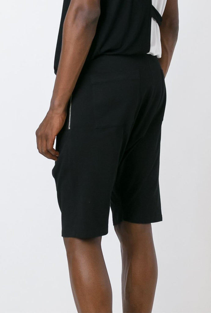 UNCONDITIONAL Black sweat double zip drop crotch shorts with side zip.