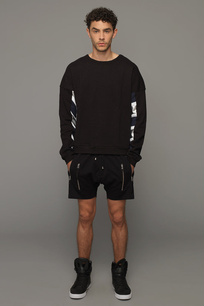 UNCONDITIONAL bitter chocolate with double zip up pockets low rise drop crotch shorts.