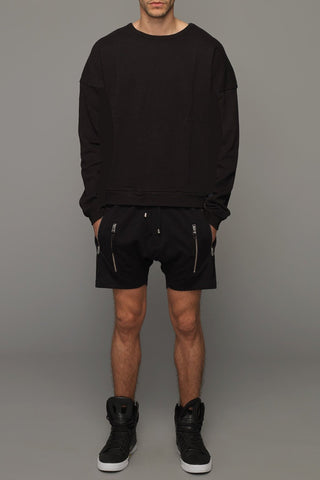 UNCONDITIONAL black microfibre drop crotch shorts with elastic waist band.