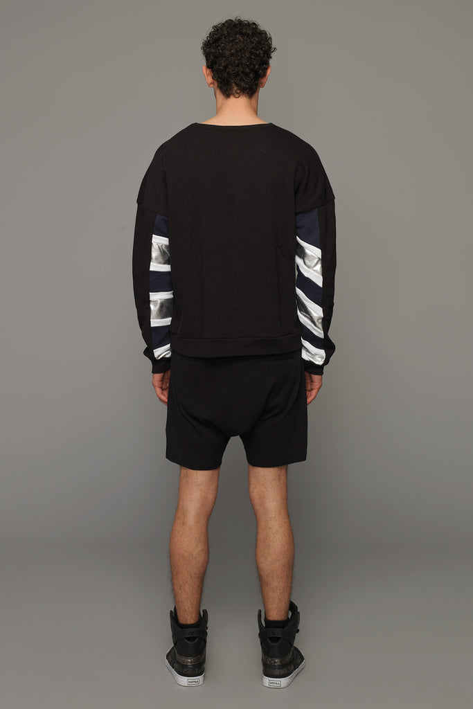 UNCONDITIONAL Stone low rise, drop crotch shorts with double silver zip pockets