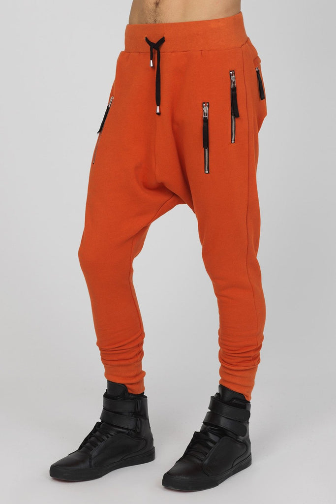 UNCONDITIONAL AW17 Burnt Orange drop crotch full length double zip pocket sweat trouser.