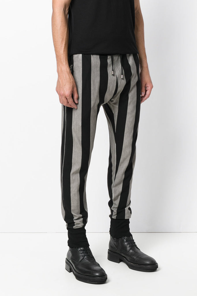 UNCONDITIONAL Black and Stone cold dye striped slim trousers , with zip up pockets.